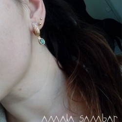 Set with emeralds